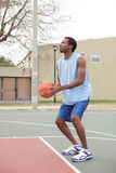 Basketball player about to toss the ball Stock Image