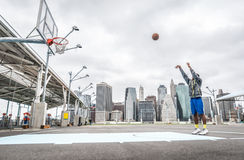 Basketball player training shots on the court Stock Photography