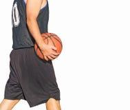 Basketball player walking on white Royalty Free Stock Photos