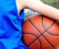 Basketball player wearing blue uniform with the ball Royalty Free Stock Images