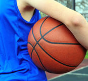 Basketball player wearing blue uniform with the ball Stock Photo