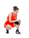 Basketball player. Woman having knee pain isolated on a white background Stock Image