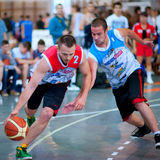 Basketball players. BUCHAREST, ROMANIA - MAY 20: Unknown basketball players performs during the game Sport Arena Streetball 3x3, Play On (red) vs. Tiki Taka Stock Photo