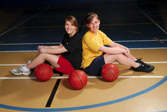 Basketball Players. Two teenage basketball players in school gymnasium Royalty Free Stock Photos