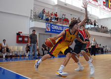 Basketball players in action Stock Images