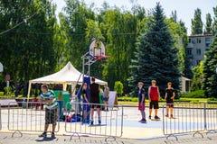 Basketball players on basketball playing field before game outdo. Kremenchug, Ukraine - June 5, 2017: Basketball players on basketball playing field before game Royalty Free Stock Photos
