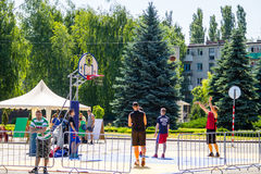 Basketball players on basketball playing field before game outdo. Kremenchug, Ukraine - June 5, 2017: Basketball players on basketball playing field before game Royalty Free Stock Photography