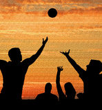 Basketball players on court at sunrise sunset Royalty Free Stock Photo