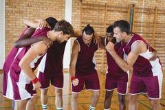 Basketball players forming a huddle Stock Image