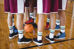 Basketball players forming a huddle Royalty Free Stock Images