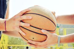 Basketball players holding the ball. Fairplay concept. Royalty Free Stock Photography