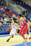 Basketball players Olympiakos (Greece, in red) Stock Image