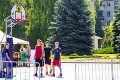 Basketball players on basketball playing field before game outdo. Kremenchug, Ukraine - June 5, 2017: Basketball players on basketball playing field before game Stock Photos