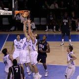 Basketball players rebounding Stock Photo