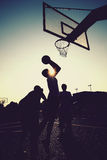 Basketball players silhouettes. Playing outside Stock Photos