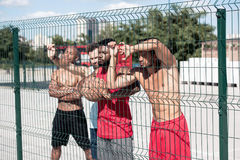 Basketball players standing near net at court Royalty Free Stock Images