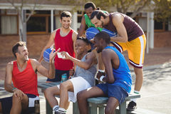 Basketball players taking a selfie. In basketball court outdoors Stock Image