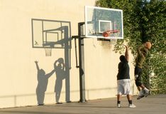 Basketball players and their shadows