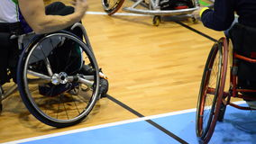 Basketball players in a wheelchair during a dead time a basketball game stock video footage