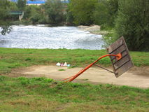 Basketball playground on the bank of the river Vrbas with broken pillar, after terrible floods Stock Photos