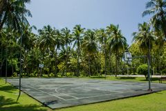 Basketball playground at the tropical island near jungles Stock Photo