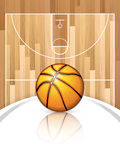 Basketball. A realistic vector hardwood textured basketball court with basketball in the center court Royalty Free Stock Photo