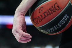 Basketball Referee holds a ball. Basketball Referee holds a an official basket ball of Euroleague Stock Images