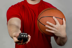 Basketball and Remote Control. Royalty Free Stock Image