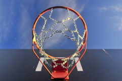 Basketball ring outside with sky and cloud. With iron chains Stock Photo