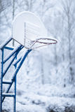 Basketball ring in winter Royalty Free Stock Photo