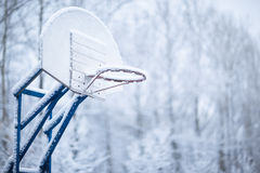 Basketball ring in winter Royalty Free Stock Photos