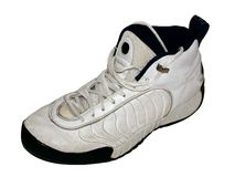 Basketball shoe. White basketball shoe on white background stock photography