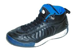 Basketball shoe 2. Black basketball shoe on white background royalty free stock photo