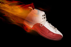 Basketball Shoe on Fire. With black background Stock Photos