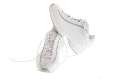 Basketball Shoes. A pair of white basketball shoes isolated on a white background Royalty Free Stock Photo