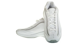 Basketball shoes. A pair of white basketball shoes isolated on a white background Royalty Free Stock Photography