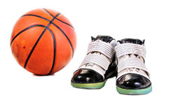 Basketball and shoes Royalty Free Stock Images