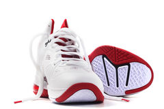 Basketball shoes one lay down Stock Images