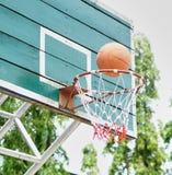 Basketball. Shooting Basketball through the basket at a sports arena Royalty Free Stock Photo