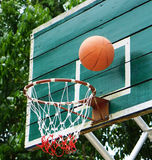 Basketball. Shooting Basketball through the basket at a sports arena Royalty Free Stock Images