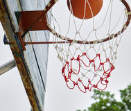 Basketball. Shooting Basketball through the basket at a sports arena Stock Photos