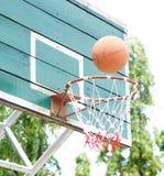 Basketball. Shooting Basketball through the basket at a sports arena Stock Photo