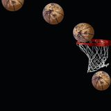 Basketball shot. Display basketball while going through a basketball hoop. The ball is with the appearance of the globe, all isolated on a black background Stock Photography