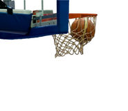 Basketball shot. Action shot of basketball going through basketball hoop and net on white background stock photography
