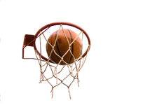 BASKETBALL SHOT. Action shot of basketball going through basketball hoop and net on white backgrounds royalty free stock photography