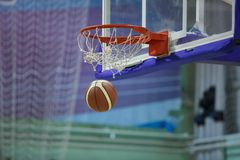 Basketball shot. Ball in the hoop royalty free stock photography