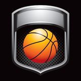 Basketball on silver display Royalty Free Stock Image
