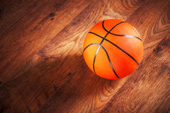 Basketball sitting on court Royalty Free Stock Images