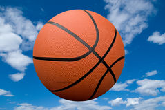 Basketball with sky Stock Images