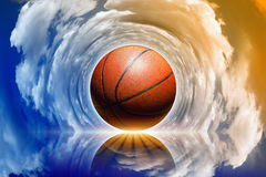 Basketball in sky Royalty Free Stock Image